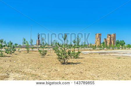 The view on the ruins of Ak-Saray Palace and the monument of Amir Timur Shakhrisabz Uzbekistan.