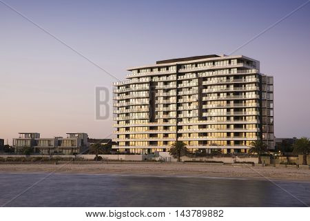 High rise apartments by the beach at sunset.