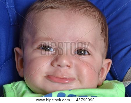 Beautiful little baby boy portrait,happy and smiling.