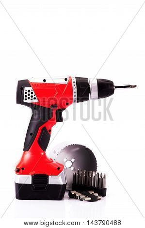 red cordless drill on a white background
