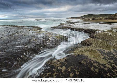 Tidal stream at a beach in Australia.