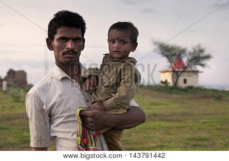 PUNE, MAHARASHTRA, INDIA - July 19 2010: Portrait of father and son in rural India.