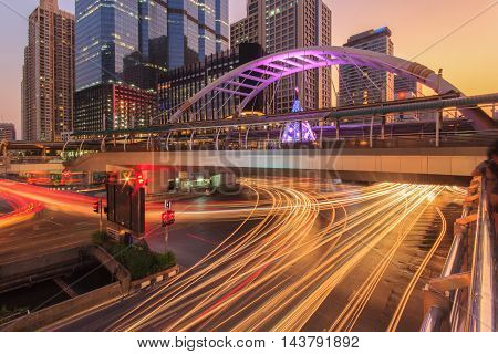 Modern building at night. Traffic in the business district The Skytrain station Chong Nonsi