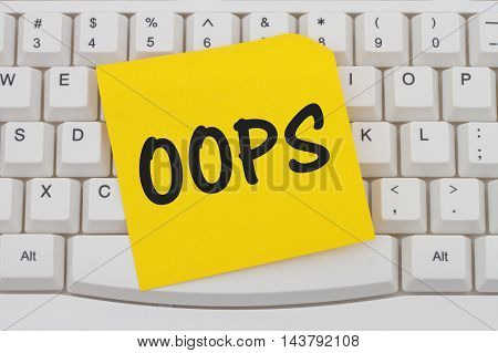 Having problems with your computer A close-up of a keyboard with yellow sticky note with text Oops