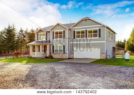 Two Level Blue Country Farm House With Rocks Trim