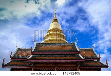 the low angle of golden Pagoda behind the Thai style temple at northern of Thailand.