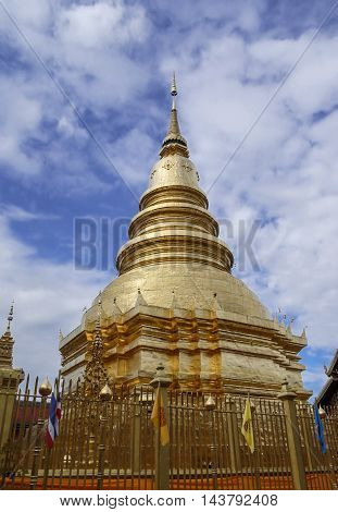 the very high golden Pagoda in Lhumphun province