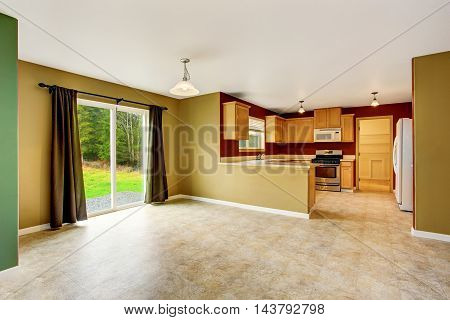 Open Plan Interior Connected To Kitchen Room With Red Walls
