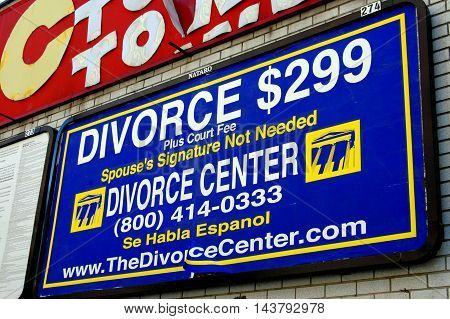 New York City - October1 2005: Sign on a C-Town supermarket wall advertises divorces for $299 in Harlem's Hamilton Heights