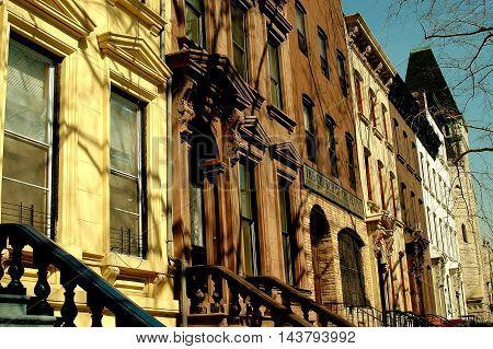 New York City - April 6 2005: Elegant brownstones on West 130th Street in Harlem
