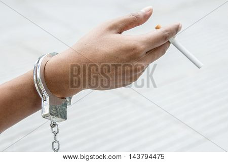 Hand With Shackle Show Addict Cigarette