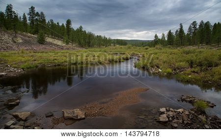 Evening landscape on the creek in South Yakutia Russia in cloudy weather