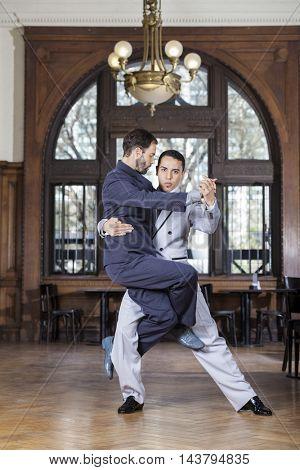 Confident Tango Dancer Lifting Male Partner