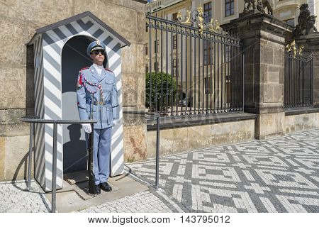 PRAGUE, CZECH REPUBLIC, JULY 7,2016: Prague Castle Guard with his summer uniform, guarding and defending the seat of the President of the Czech Republic at the Prague Castle.