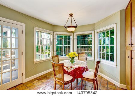 Dining Room Interior With Table Set And Many Windows.