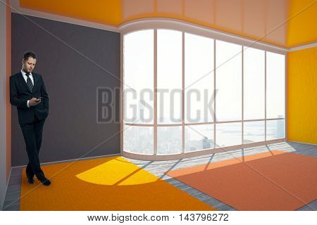 Businessman using smartphone in colorful interior with city view and daylight. 3D Rendering