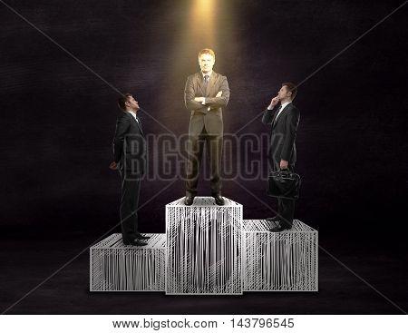 Businesspeople on winner's podium. Chalkboard background. Leadership concept