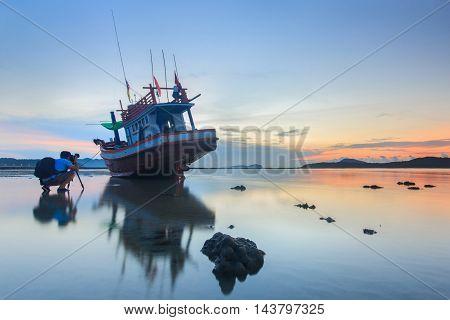 Photographer take a photo sunrise at the Rawai beach in Phuket Thailand