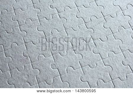 Close-up jigsaw puzzle pattern on a paper