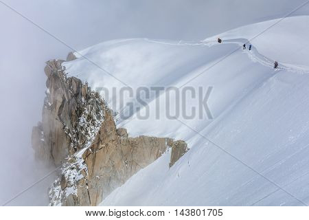 Climbers on the Mont Blanc massif. View from Aiguille du Midi Mount -3842 m France