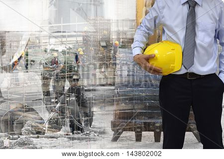 Work safety concept : work out door at construction site during used personal protective equipment   by hard hat .