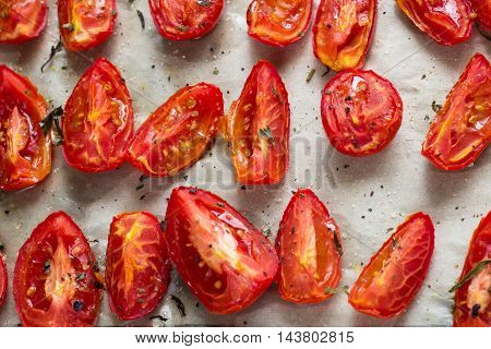 Sun dried tomatoes on white baking paper view from above