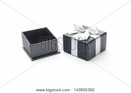 opened black box wrapping white ribbon bow isolated on white
