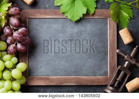 Red and white grapes and chalkboard for your text. Top view with copy space