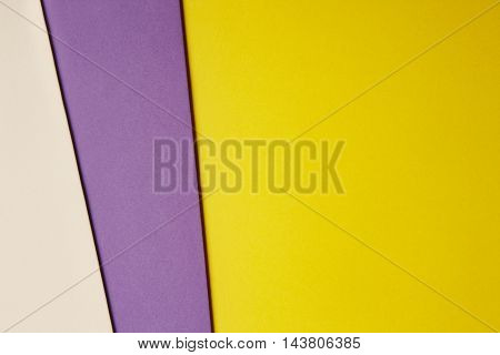 Colored cardboards background in yellow purple beige tone. Copy space. Horizontal
