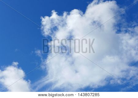 White soft cloud on clear blue sky