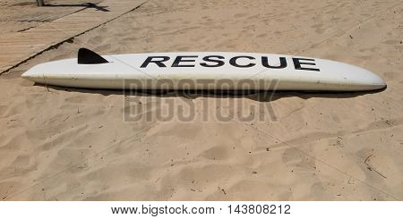 White Coast Guard Rescue Surfboard On The Sea Beach