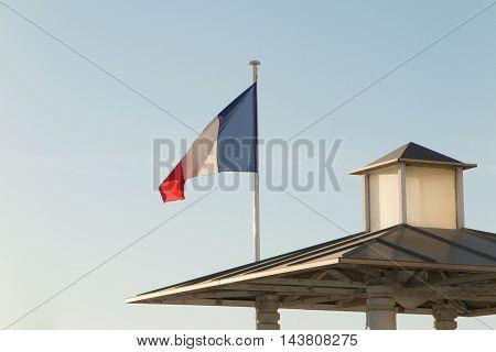 French Flag Against Blue Sky Waving Summertime