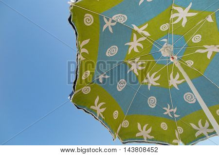 Colorful Parasol Directly Above The Sun Summer Holidays