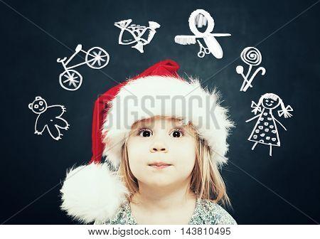 Little Girl in Santa Hat dream on Gifts. Christmas Child