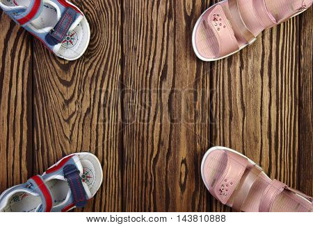 Child's sandals on a wooden background