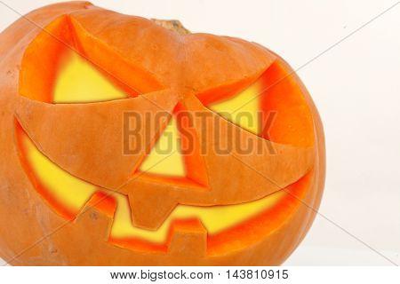 Spooky halloween pumpkin Jack O Lantern shiny inside on white background