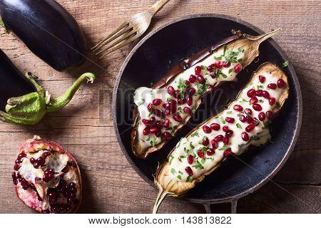 eggplants with garlic yogurt sauce and pomegranate
