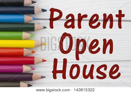 Pencil Crayons with text Parent Open House with weathered wood background