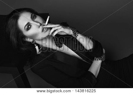 Elegant Hot Brunette Woman Smoking A Cigarette