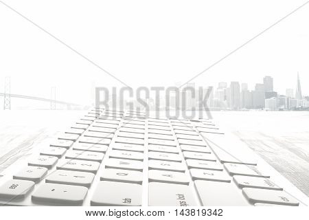 Closeup and side view of white computer keyboard on abstract foggy city background. 3D Rendering