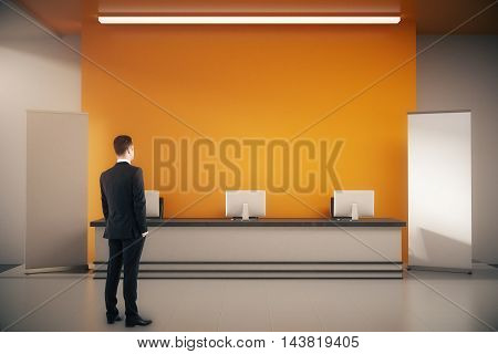 Businessman In Interior With Reception