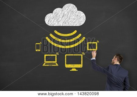 Cloud Computing Concept Drawing on Blackboard Working Businessman Conceptual