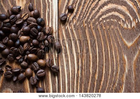 Coffee beans on wood table. Food background