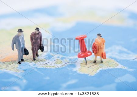 Miniature business people travel on world map. business international travel concept