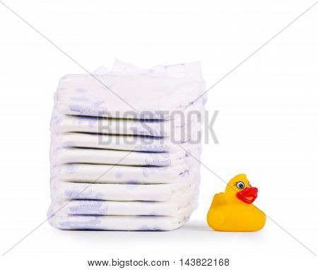 Disposable diapers and the rubber duckling isolated on white background
