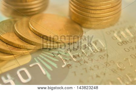 pile coin money with credit card account book finance and banking concept for background.