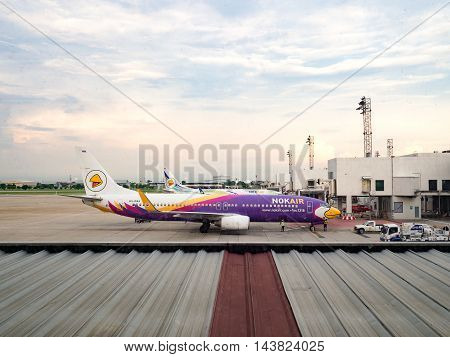 BANGKOK THAILAND JULY 24 2016: Airplane Thai Nokair parking on Bangkok International Airport (Don Muang) Bangkok. Engineers are maintain the engine of the aircraftThailand. July 24 2016.