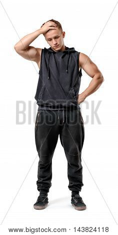 Full body portrait of handsome muscled young man thinking with hand on his head isolated on white background. Fitness, sport, bodybuilding, workout. Wellness and beauty. Problems and solutions.