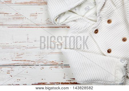 Baby clothes on wooden background
