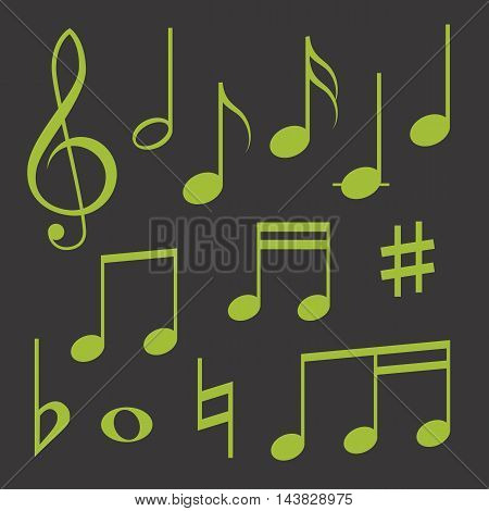 Set of musical symbols, green on dark background